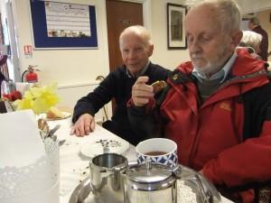 Enjoying coffee and cake after Wednesday morning Mass